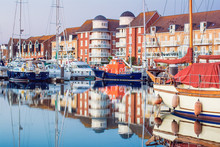 Yachts And Houses In Sovereign Harbour In Eastbourne, Reflection In The Water, Selective Focus, England, United Kingdom