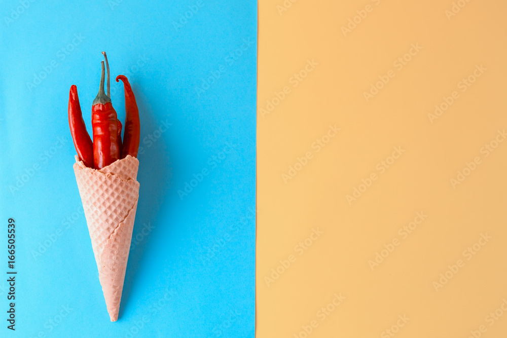 Fototapety, obrazy: Unusual ice cream. Red hot chili peppers in a wafer cone