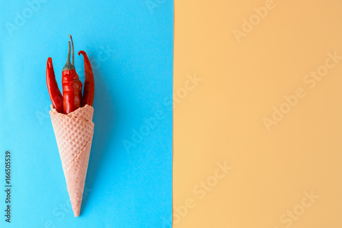 Unusual ice cream. Red hot chili peppers in a wafer cone Canvas Print