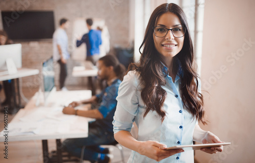 Photographie  Beautiful businesswoman portrait in modern  company office