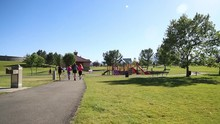 Runners Jog Around A Park In K...