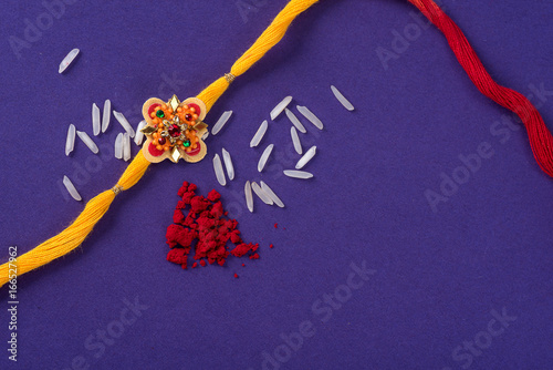 Fotografering  Raksha Bandhan : Rakhi with rice grains and kumkum