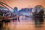 Genoa city center harbor and Biosphere in Acquario. Porto Antico during evening time.