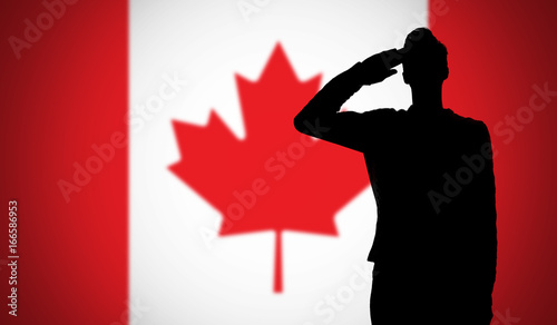 Silhouette of a soldier saluting against the canada flag фототапет