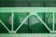 Leinwanddruck Bild - close up of green metal bridge structure for support trains