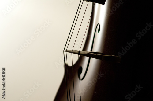 Cello strings close-up Fotobehang