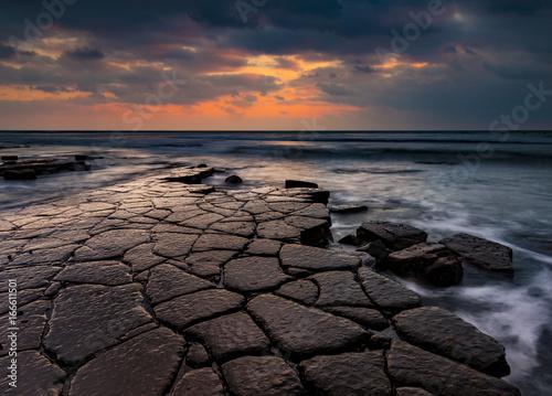 Photo Kimmeridge ledges at sunset on the Jurassic Coast