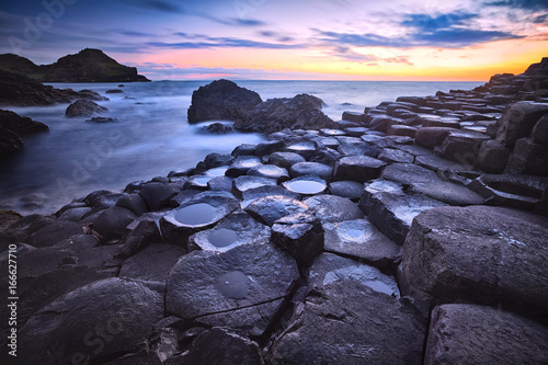 Printed kitchen splashbacks Eggplant sunset over basalt rocks formation Giant's Causeway, Port Ganny Bay and Great Stookan, County Antrim, Northern Ireland, UK