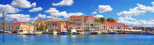 Foto auf Leinwand Santorini Colorful panoramic HDR image of the beautiful old Venetian Harbour of the city of Chania with boats and yachts on cloudy blue sky and turquoise water, Crete, Greece