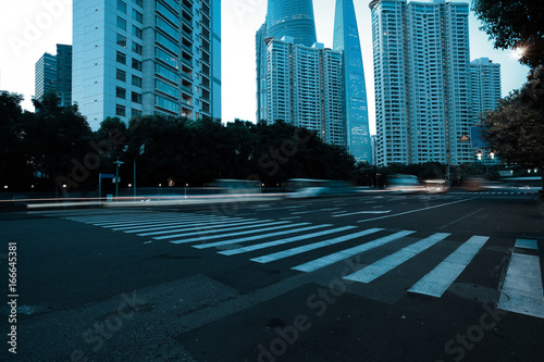 Empty road surface with city landmark buildings of evening Poster