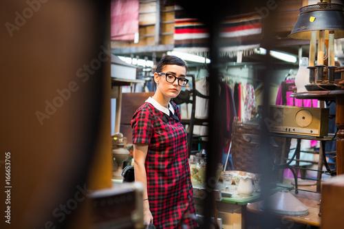 Beautiful brunette in a flea market