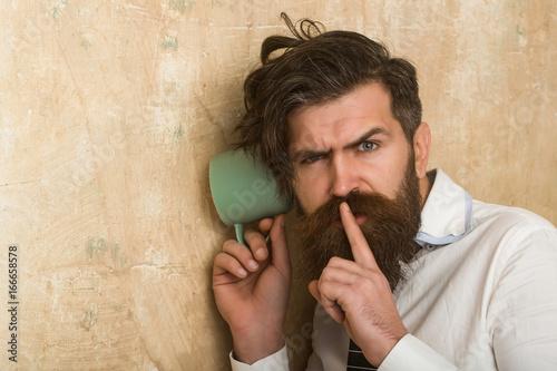 guy listen at wall.