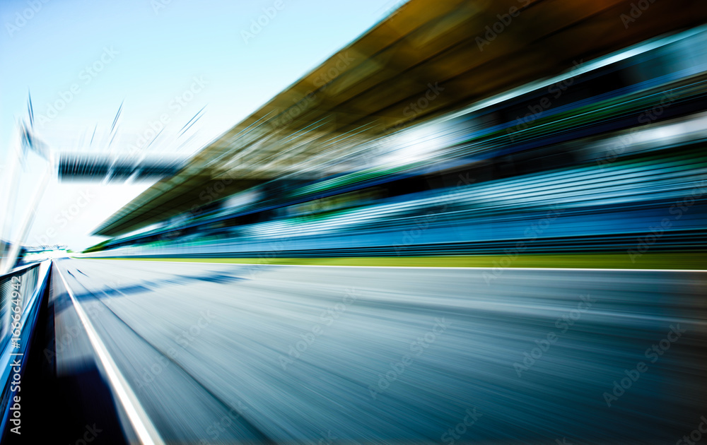 Fototapeta Racetrack in motion blur, racing sport background .