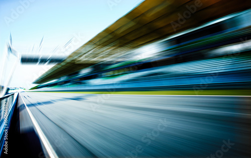 Racetrack in motion blur, racing sport background .