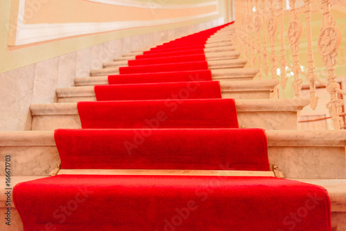 Photo Stands Stairs Interior stairs with red carpet - Majestic interior marble stairs from a luxury building covered with red carpet
