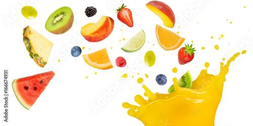 Poster Fruit fruit cocktail falling into splashing yellow juice
