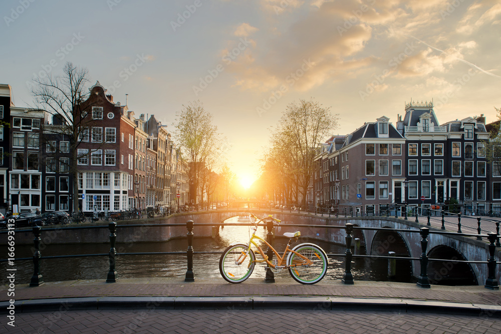 Bicycles lining a bridge over the canals of Amsterdam, Netherlands. Bicycle is major form of transportation in Amsterdam, Netherlands.
