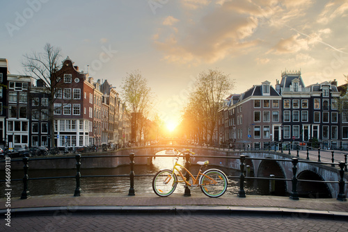 Bicycles lining a bridge over the canals of Amsterdam, Netherlands Wallpaper Mural