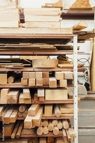 Wood Wood on shelves at workshop