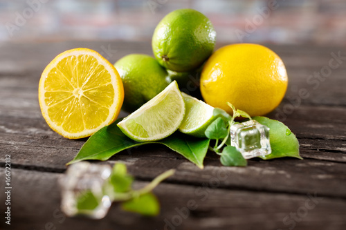 Healthy lime and lemons summer freshness fruits background.