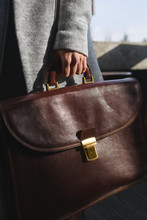 Woman Holding Business Briefcase