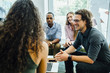 canvas print picture - Diverse group of coworkers meeting in modern office space