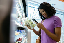 Woman In Convenience Store On ...