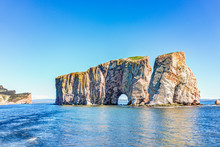 Rocher Perce Rock In Gaspe Peninsula, Quebec, Gaspesie Region With Birds And Cliffs During Day