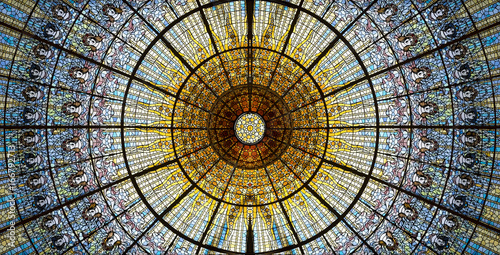 Palau de la Musica Catalana skylight of stained glass designed by Antoni Rigalt i Blanch whose centerpiece is an inverted dome in shades of gold, Barcelona, Spain.