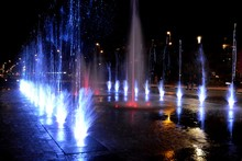 City Fountain Hot Summer Night And Colorful Illuminations