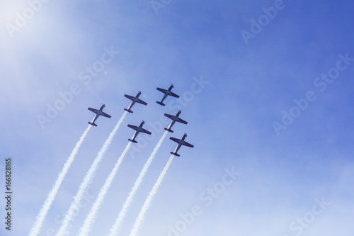 Fototapeta  Jet planes showing beautiful maneuver