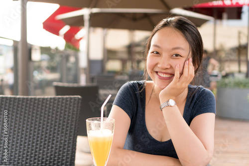 Chinese girl in cafe Canvas-taulu