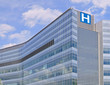 Building with large H sign for hospital