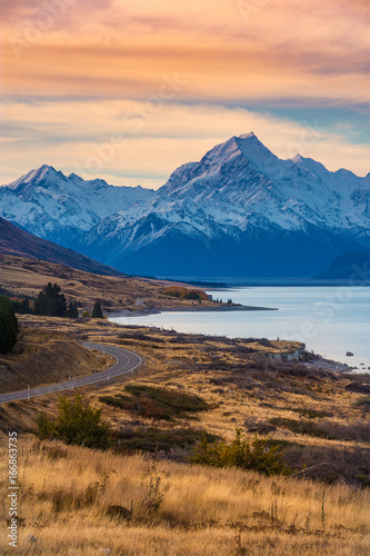 Poster Bergen Colorful sunset scenery of Aoraki Mount Cook national park in autumn in south island, New Zealand. Snow moutain with lake and road.