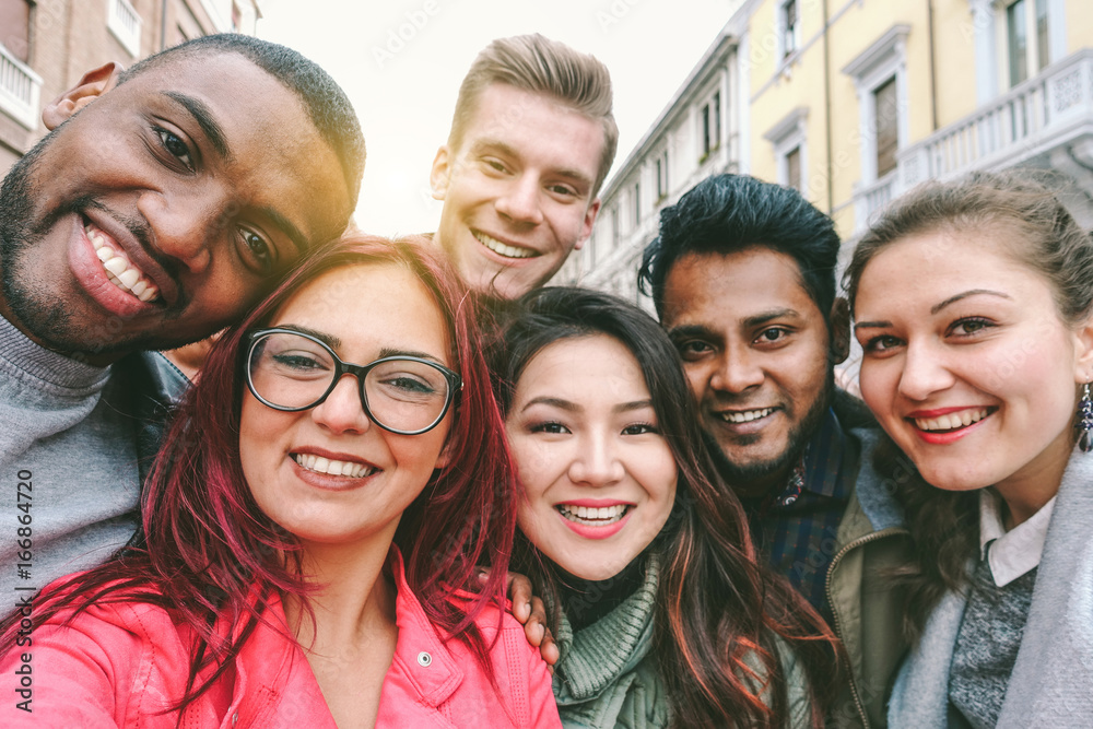 Fototapety, obrazy: Happy friends from diverse cultures and races taking selfie with back lighting