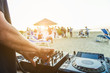 canvas print picture Dj mixing at sunset beach party in summer vacation