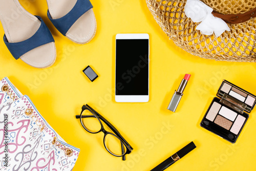 Feminine Clothing And Accessories On Bright Yellow Background Top View