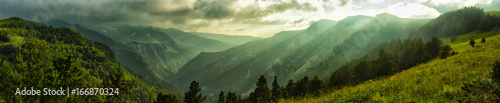 Foto auf Acrylglas Schlucht Mountains with canyons and peaks in a storm