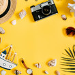 Flat lay traveler accessories on yellow background with blank space for text. Top view travel or vacation concept. Summer background.