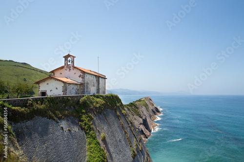 Ermita en Zumaia con el mar de fondo Poster