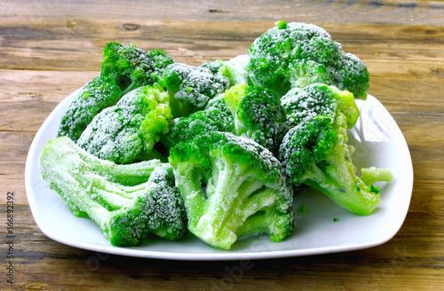 Fresh frozen broccoli on white plate
