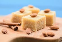 Indian Traditional Dessert, Halva Made With Semolina And Milk Wih Cinnamon And Almonds On Blue Background Close Up