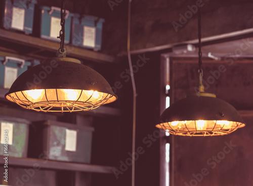 Papiers peints Affiche vintage Modern and vintage fashion lamp Edison interior loft room. Lantern with filament.