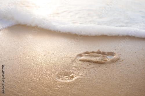 Papiers peints Cappuccino pied dans le sable