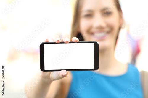 Female showing a blank horizontal phone screen