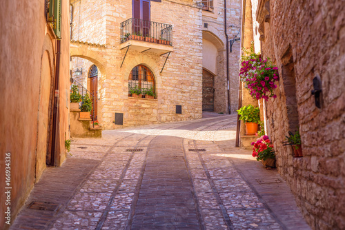Fototapety, obrazy: SPELLO, ITALY - MAY 27, 2017 - View of a typical alley of Spello, a medieval and beautiful town in Umbria.
