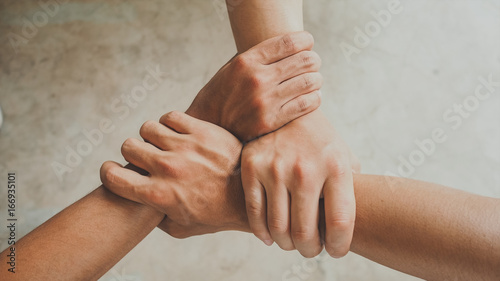 Three human join hands together, collaboration concept of business and education teamwork, soft focus and vintage color tone process