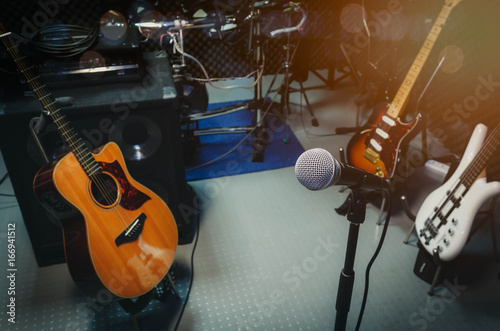 instrument rock music / musical band at home audio record room / studio recording. Equipment this event the microphone acoustic and electric guitar bass electronic drum and sound audio control panel. - 166941512