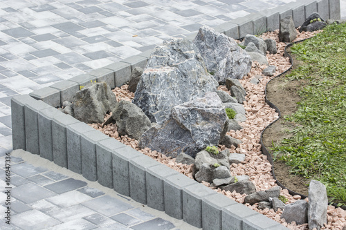 Fotografie, Obraz  Artificially created rocks with side palisades and lawns.