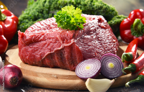 Fotografering  Piece of beef and spices on cutting board